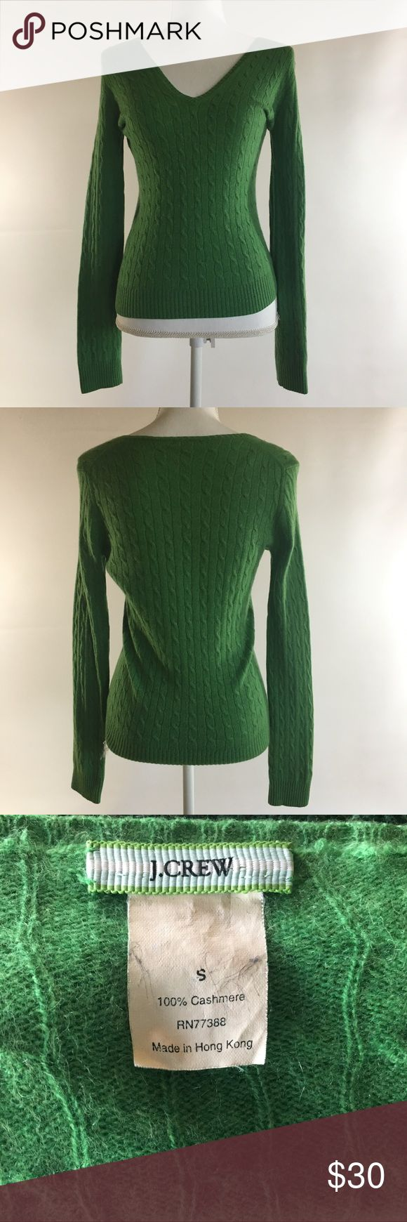 "J. Crew Women's S green Cashmere Sweater Description J. Crew Womens Small Green Cable knit V-Neck sweater 100% cashmere overall in good condition- no stains. There is a very small repair next to the inside arm seam about 1/2 way down- see closeup, it is not noticeable. Measurements: 24.5"" in length from top of shoulder to  bottom hem 19"" across flat front of chest J. Crew Sweaters V-Necks"