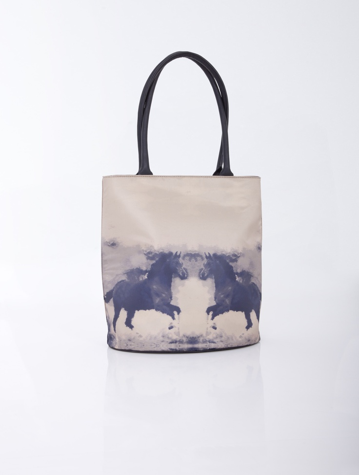 Hand and shoulder bag with a horse theme.