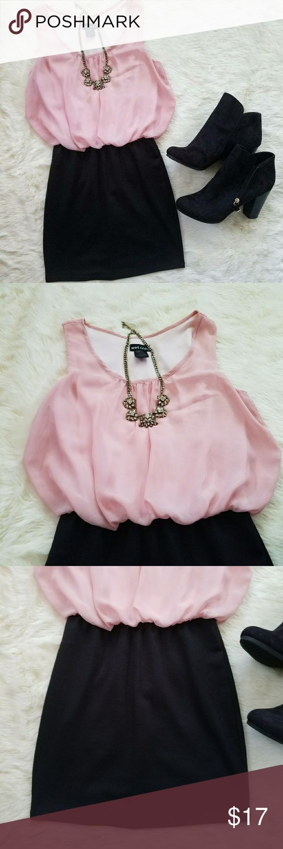 Pink and Black Dress Top very beautiful light pink. Flowy kind sheet material but light pink underlay so not see through! Top is tight black. Skirt is about 14.5 inches long. Whole dress is (measured shoulder to bottom of skirt) Is about 30 inches long. Very cute dress, works for so many different occasions. Only wore once! Wet Seal Dresses Mini