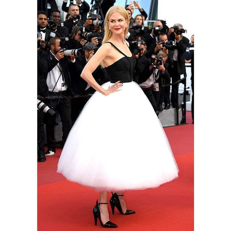 Statuesque beauty: Actress @nicolekidman walks the #Cannes2017 red carpet in a Calvin Klein By Appointment satin bustier and hand cut silk tulle skirt adorned with delicate suspenders. The look was finished with Fall 2017 CALVIN KLEIN 205W39NYC black patent pumps.
