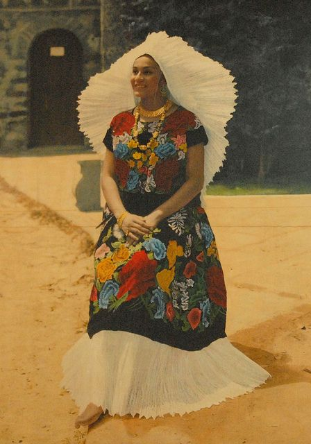 La Tehuana Oaxaca This is a photo of an old photograph displayed in the post office in the city of Oaxaca, Mexico. It shows a woman (a model most likely) wearing a huipil and skirt . She also wears the magnificent headdress .