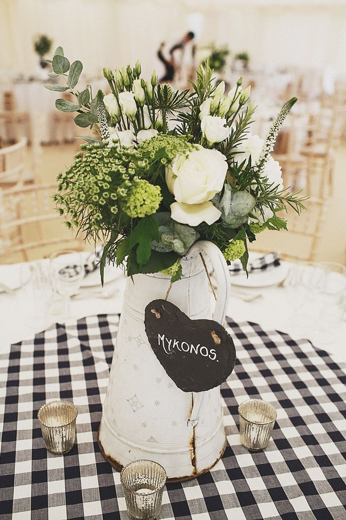 Enamel Pitcher Jug Table Centrepieces filled with White Blooms | Rustic Country Marquee Reception in Wales | Bride in a Bespoke Gown and Bridesmaids in Navy Gingham Boden Dresses | Image by Debs Ivelja Photography | http://www.rockmywedding.co.uk/anna-russ/