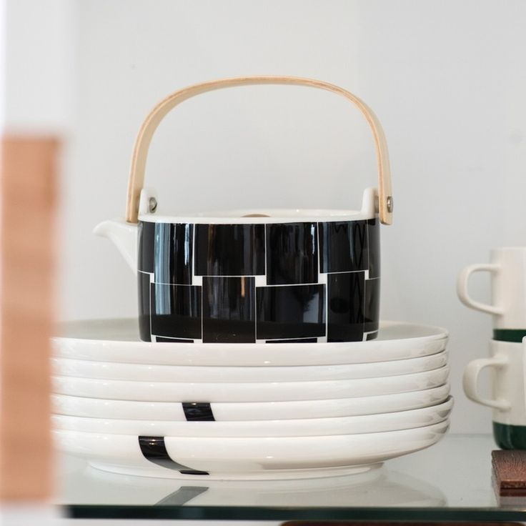 New to the Oiva ceramic range Basket Teapot. This wood handled teapot features the new minimalist Basket pattern designed by Carina Seth Andersson and the design by Sami Ruotsalainen. The pot, strainer and wood-knob lid are made of white stoneware. Hand wash; glazed colors and pattern remain vibrant. Also available in a new mug and great to use alone or combine with the other ceramics in the marimekko ranges. Contemporary design for life.