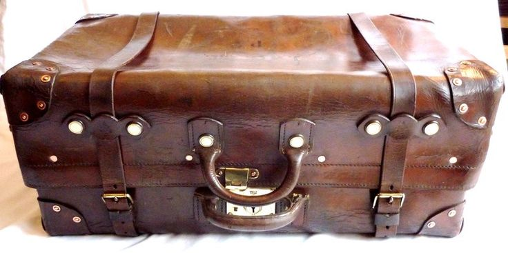 This is a super example of a really early English leather trunk, made by John Pound around 1900. The trunk is in wonderful condition, and has brass and copper studs and hardware all round.