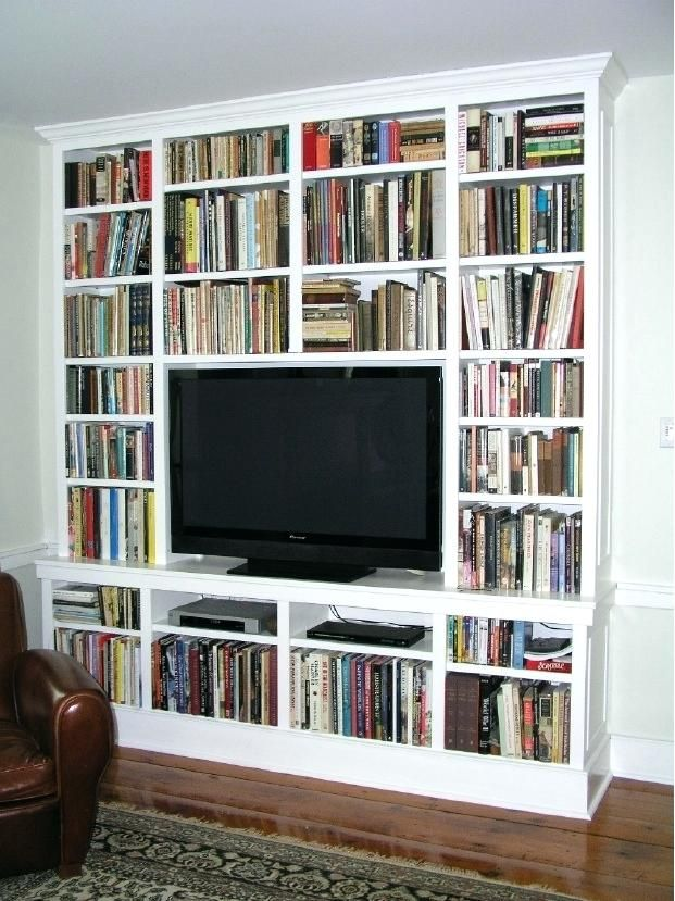 Built In Bookcases With Tv A Flat Screen Surrounded By Books