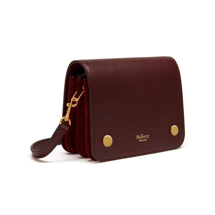 Shop the Small Clifton in Oxblood Natural Grain Leather at Mulberry.com. The Small Clifton is a compact, understated shoulder bag that cleverly camouflages an organiser's paradise underneath its neat exterior. Internal compartments provide ample room for essentials, and the leather strap can be adjusted and styled in different ways. Signature press studs and a subtle Mulberry logo are the final embellishments.