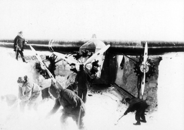 "1929: Admiral Richard Byrd's famous flight to the South Pole and back is launched November 28. Byrd, along with pilot Bernt Balchen, co-pilot and radioman Harold June, and photographer Ashley McKinley, flew the Ford Trimotor ""Floyd Bennett"" to the South Pole and back in 18 hours, 41 minutes. Crew members dig out the Floyd Bennett from its snowy hangar."