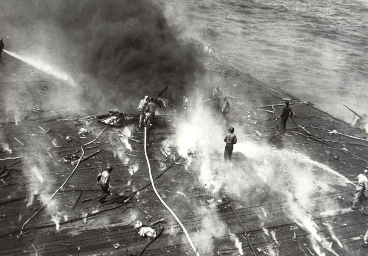 Black smoke pours from the aircraft carrier Yorktown after she suffered hits from Japanese aircraft during the Battle of Midway, on June 4, 1942. (U.S. Navy)