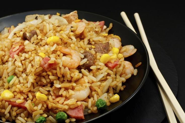 Japanese fried rice (cha-han) on matte black round plate.