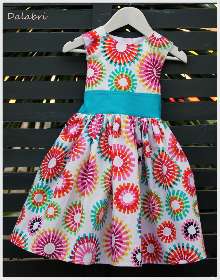 Perfect Party Dress in a lovely retro bright printed fabric. Pattern by Tie Dye Diva.