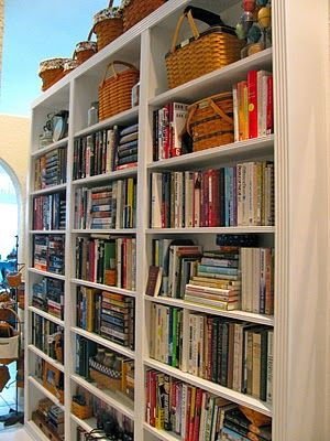 Hallway library.  My husband used this blog's guidance to build a shallow bookcase down the length of our hallway, floor to ceiling, only 8-inches deep which is all you need for most books.  It's wonderful!  And I love the library/study look it adds to our house.  It saves having big, deep bookcases taking up space in our rooms.