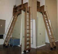 Loft ladder stores flush to the wall, then pulls out for climbing.