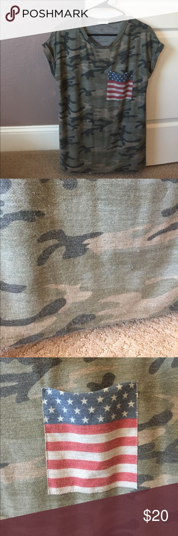 Camo Tee with American Flag Pocket Bought on Poshmark for 4th of July but probably won't wear it again! Like new condition, see pictures for only pilling. Not noticeable when worn. Make me an offer, bundle and save :) Tops Tees - Short Sleeve