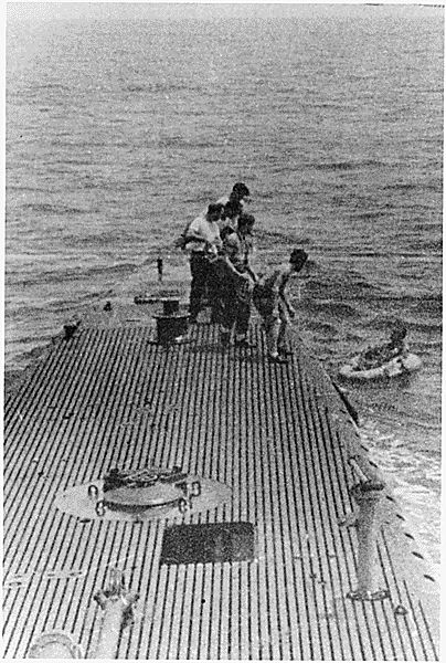 George Bush being rescued by the submarine, the U.S.S. Finback, after being shot down while on a bombing run of the Island of Chi Chi Jima, 09/02/1944.