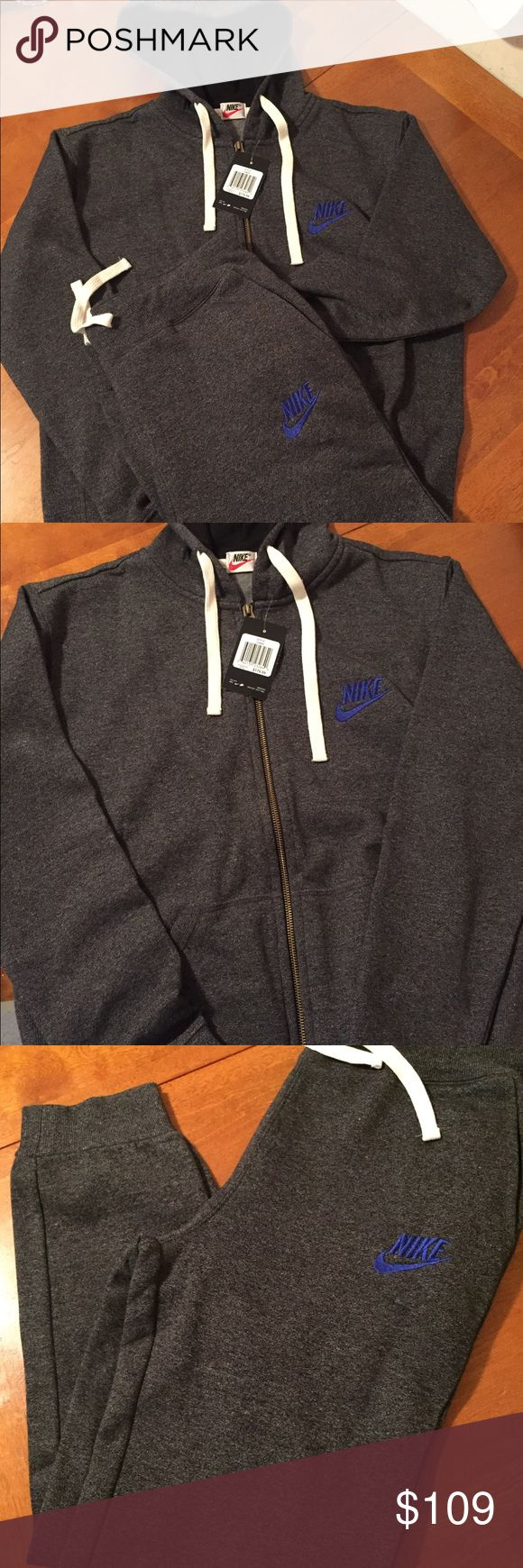 Nike sweatsuit Nike NWT size medium in men's. Charcoal grey hoodie with matching pants. Blue logo white drawstring. Fast shipping Nike Sweaters