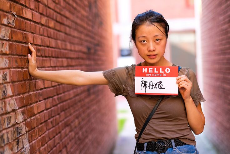 Artist in Beijing. She poses here in the art district created by Chinese artist, Ai WeiWei