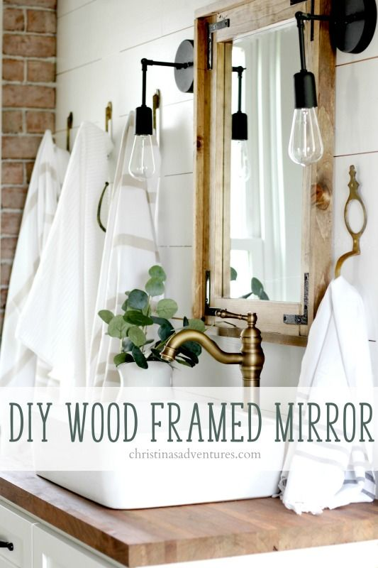 Learn how to make a wood framed bathroom mirror - the perfect addition to our farmhouse bathroom design. Much more inexpensive than other home decor options