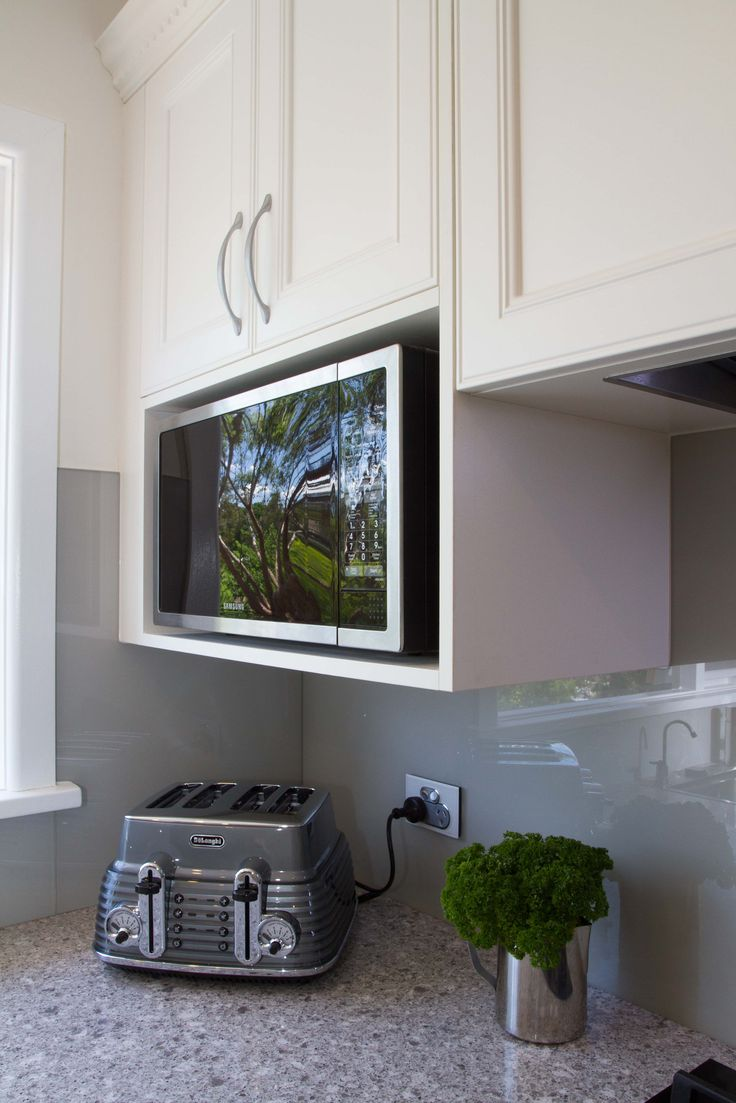 Traditional kitchen. Overhead microwave cabinet. www.thekitchendesigncentre.com.au