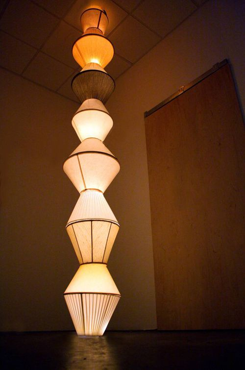 endless... (para Charles Nelson Jr.), 2006-2011, reclaimed lamp shades, various light bulbs, dust, 32 x 32 x 168 inches. - See more at: http://joanmitchellfoundation.org/artist-programs/artist-grants/painter-sculptors/2011/william-cordova#sthash.DTu0zsoO.dpuf