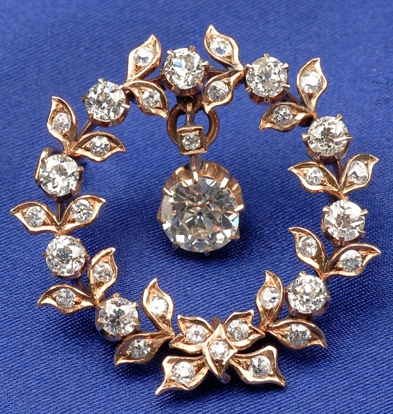 Antique Diamond Wreath Pendant/Brooch, the old mine-cut diamond weighing approx. 1.85 cts., flexibly set in a garland wreath, bead-set with old European and old single-cut diamonds, approx. total wt. 4.44 cts., lg. 1 1/2 in