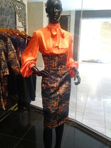 Orange pussy bow blouse with high waist skirt...available at store...winter here come!!!