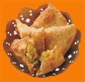 Vegetarian Indian Samosas..  to bake the samosas instead of frying use puff pastry instead of phyllo pastry.