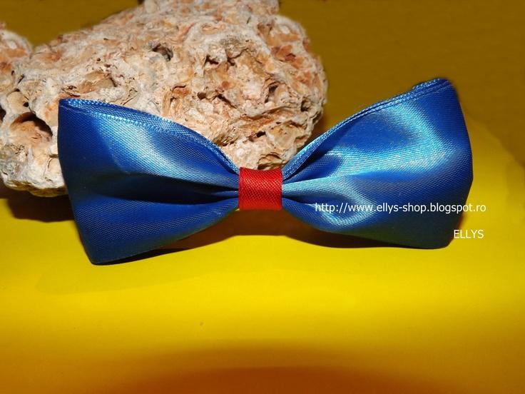 Accesoriu tip papion, prevazut cu element de prindere tip ac, astfel incat sa il folosesti exact cum iti doresti- papion, brosa, accesoriu pentru palarie etc. Dimensiuni: 12 cmX 5 cm  Mai multe detalii: http://www.tocmeli.ro/oferta/37033/papion-brosa-accesoriu  Alte modele pe blog: http://ellys-shop.blogspot.ro/
