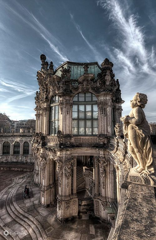 The Zwinger (Der Dresdner Zwinger) is a palace in Dresden, eastern Germany, built in Rococo style and designed by court architect Matthäus Daniel Pöppelmann. It served as the orangery (greenhouse), exhibition gallery and festival arena of the Dresden Court. Today, the Zwinger is a museum complex.