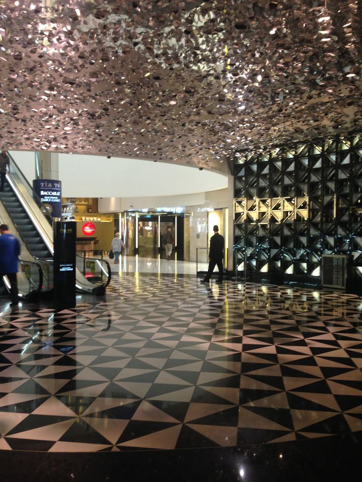 Aluminium feature petals that catch the light beautifully in a foyer at the crown casino exit.