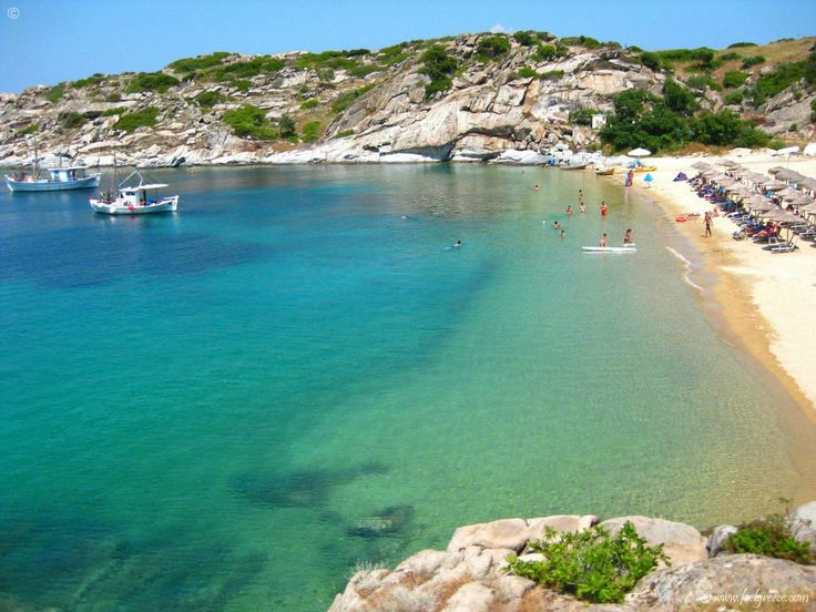 A lazy summer day at Tourkolimnionas beach, small cove with coarse sand, Sithonia