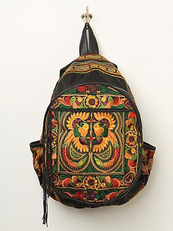 Nirvana Backpack   Handmade leather backpack, featuring vibrant embroidered upcycled textiles from Thailand. Three chambers with zip closures. Side pockets and adjustable padded straps.  *By Sabrina Tach