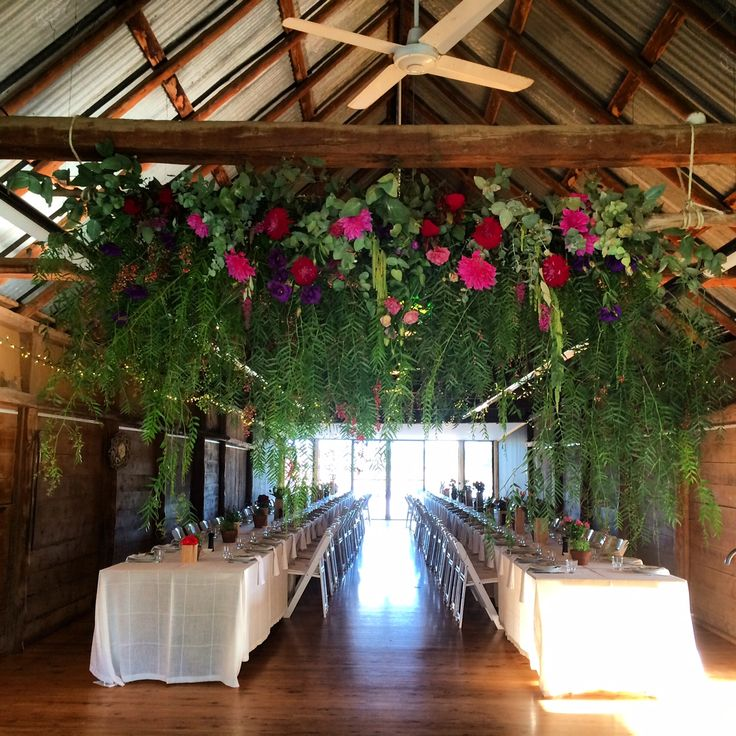 Sarah + Scott's wedding, Dundullimal Dubbo, April 2015, mink + me Hanging floral installment, mix of greenery and pink/red flowers