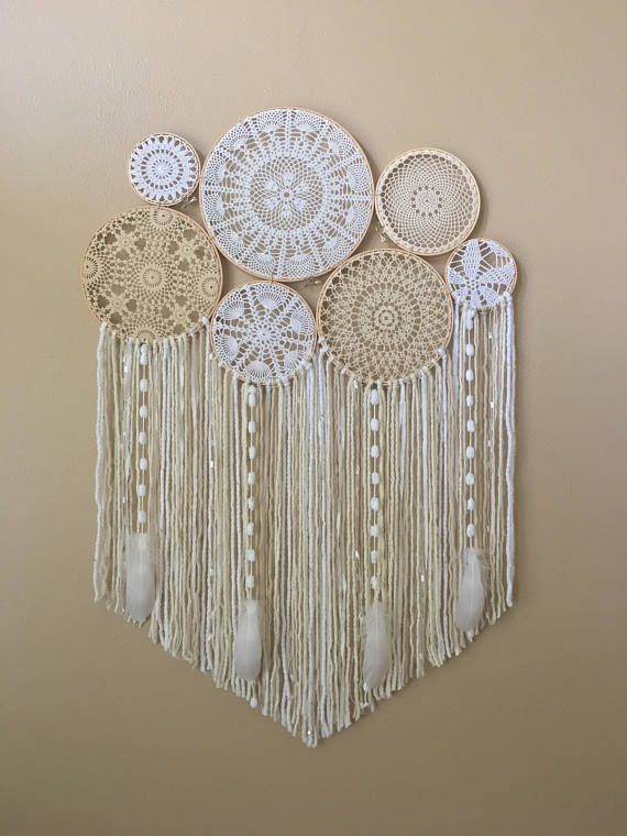 This beautiful crochet dream catcher wall hanging will add a touch of bohemian whimsy to your home or bedroom decor, dorm room, or yoga space! Dream catchers are said to protect the sleeping individual from negative dreams, while letting positive dreams through. Please Note: