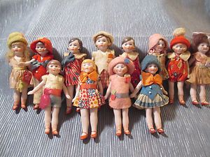 Magnificent Mint All Bisque German Miniature Brightly Dressed Dolls Set of 12