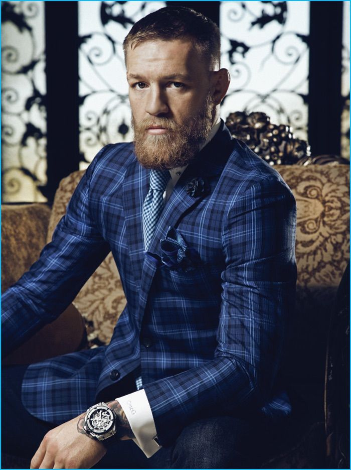 Conor McGregor pictured in a bespoke blue plaid suit from David August.