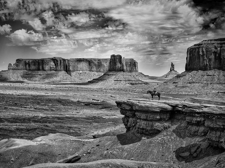 Picture of a cowboy on horseback in Monument Valley, Utah -- Carlo Mogavero  [got that whole Ansel Adams vibe going on]