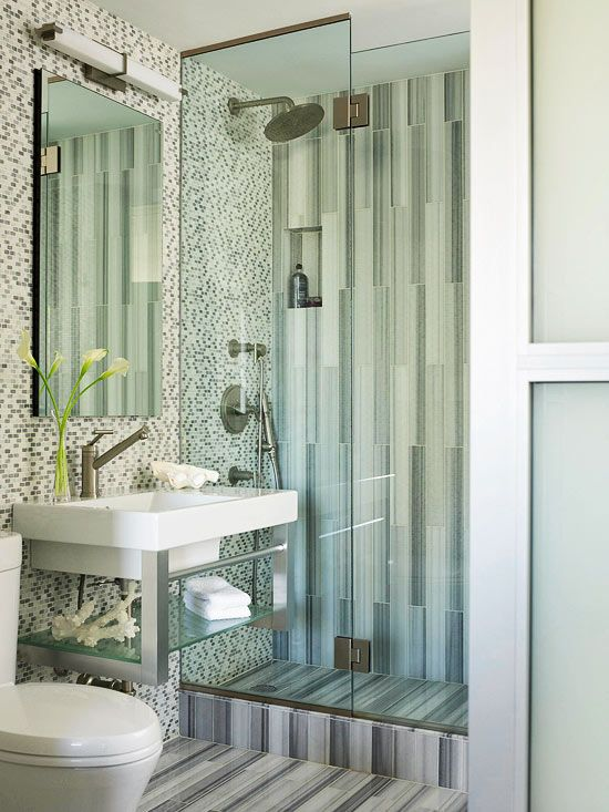 Little Luxuries..space-saving sliding door at the entrance has frosted glass to provide privacy, and running the tile vertically up the shower visually stretches the room. A rain showerhead is a luxurious touch