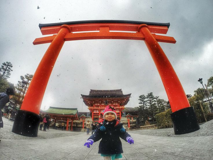 A two-year-old's first snowfall. Taken at the Fushimi Inari Shrine in Kyoto, Japan by Aris Suryamas.