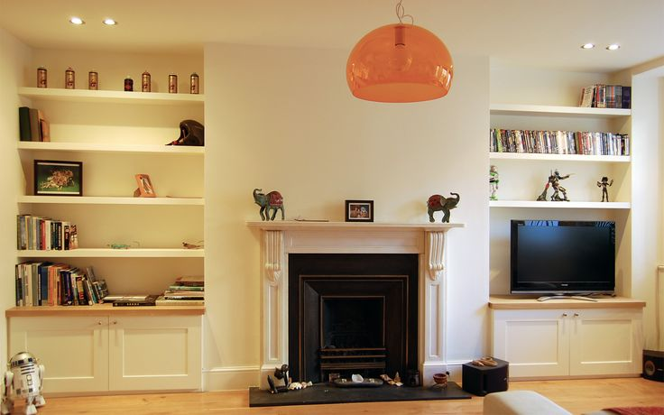 Fitted bespoke furniture - wardrobes, cupboards, shelves, bedroom furniture, offices and libraries. Professional carpenters and joiners from west London