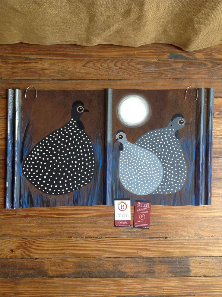 Guinea hens pained on tin by Braselton Gallery artist Debra Swantek, Hangs by a wire.