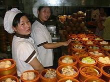 Dim sum /ˈdimˈsʌm/ (simplified Chinese: 点心; traditional Chinese: 點心; Cantonese Yale: dím sām; pinyin: diǎnxīn) is a style of Chinese cuisine (particularly Cantonese but also other varieties) prepared as small bite-sized portions of food served in small steamer baskets or on small plates. Dim sum dishes are usually served with tea, and together form a full tea brunch. Dim sum traditionally are served as fully cooked, ready-to-serve dishes. In Cantonese teahouses, carts with dim sum will be…
