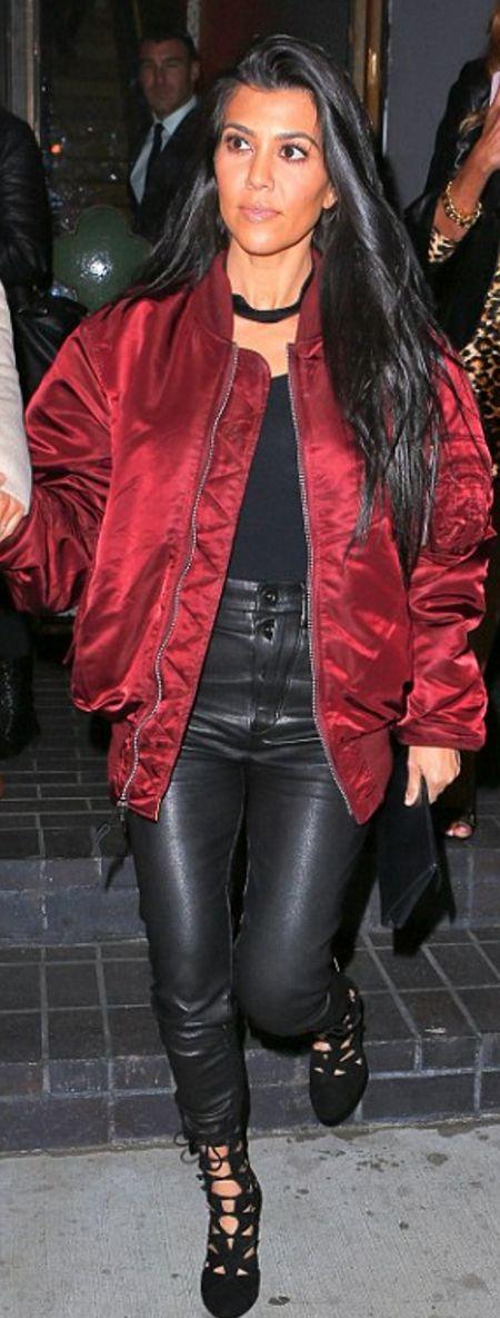 Who made  Kourtney Kardashian's red bomber jacket, black leather jacket, clutch handbag, and clutch handbag?