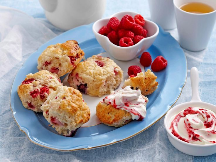 These golden, fluffy scones are absolutely beautiful with sweet berries mixed throughout. Serve your scones warm, split open with a dollop of thick cream and some fresh raspberries for a perfect afternoon tea.