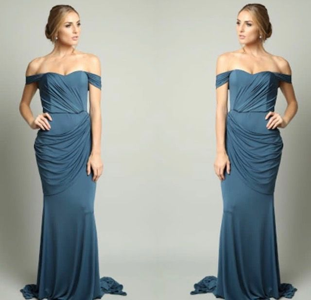 Lucy by Pia Gladys Perey. A dress to suit all shapes and sizes. This gown is stunning with off the shoulder sleeves and side skirt detail.