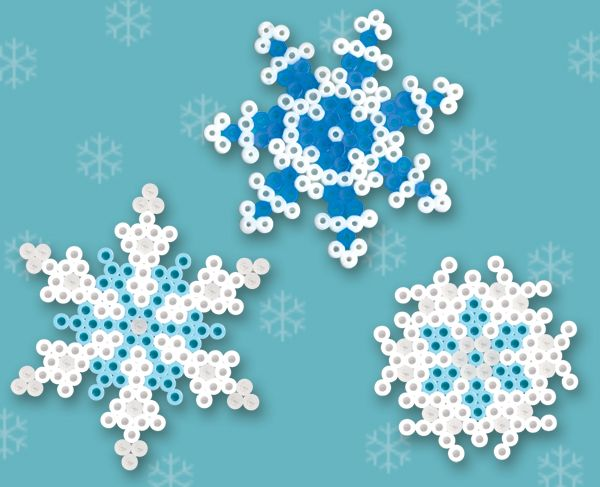 Winter Snowflakes--These are made using the daisy and small star peg board and fusible beads in white, clear, turquoise, and blue.  Project patterns included with instructions on how to make.