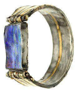 Judy Geib,    Saturn bracelet, boulder opal, 18 + 24k gold & silver
