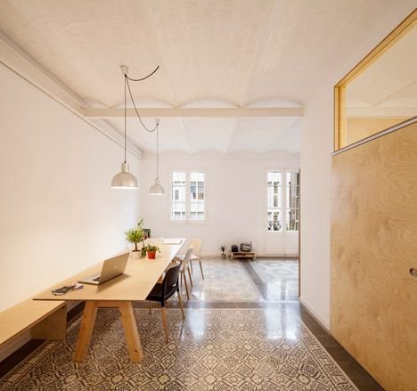 Patterned floor tiles mark out the original layout of this 1930s apartment in Barcelona, restored by local architecture student Adrian Elizalde.