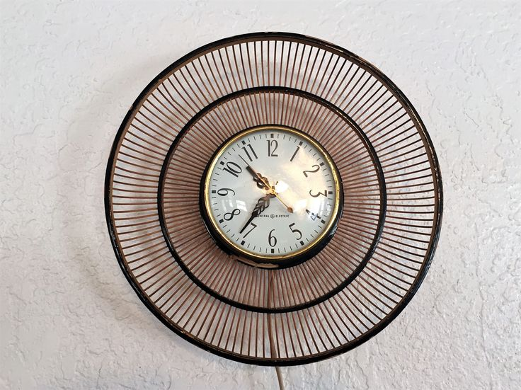 Mid Century General Electric Basket Wall Clock by NostalgicNuance on Etsy https://www.etsy.com/listing/537804179/mid-century-general-electric-basket-wall