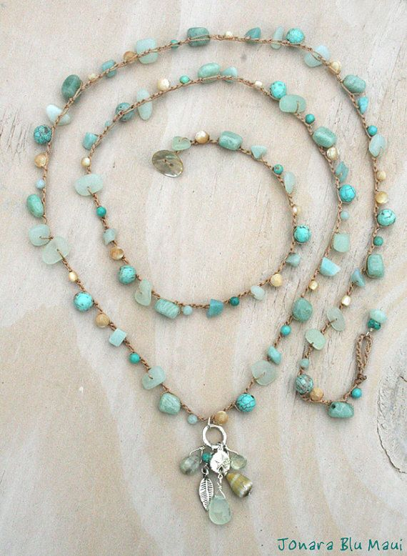 40 inches of fancy ocean color with amazonite, faceted natural mother of pearl, turquoise and sea glass made from recycled glass. The front