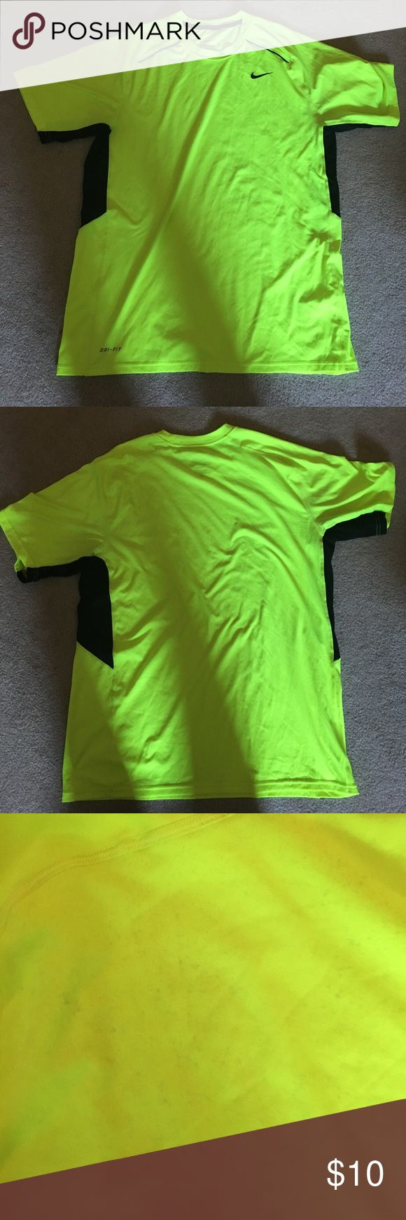 Nike Dri-Fit neon shirt. Size large Nice and light material. On the back of the shirt if you look closely there are black little dots but from a far you cannot notice them. Nike Shirts Tees - Short Sleeve